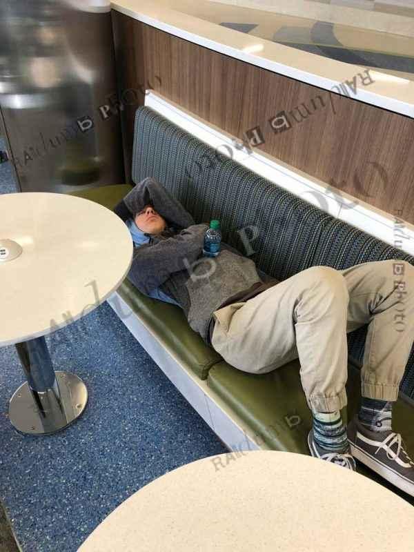 Teen sleeping in airport
